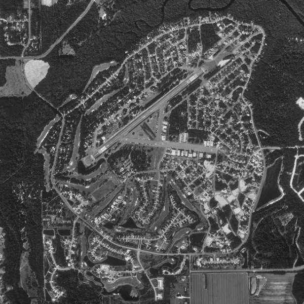Spruce Creek formerly was a Navy landing field. The relief from the big cities that garden cities promised with their small scale arrangements and their reintegration of urban dwelling into a predominantly countryside setting is seems to be a basis for Conway's fly-in communities.